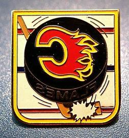 OFFICIAL CALGARY FLAMES NHL HOCKEY STICK PUCK SOUVENIR PIN B